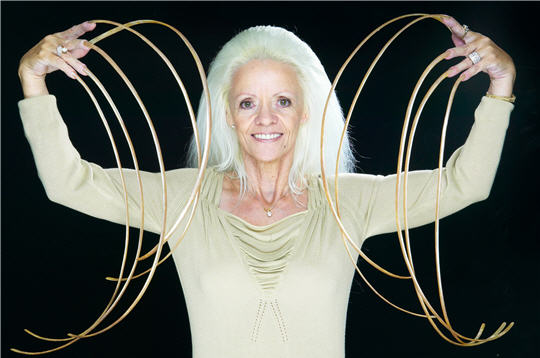 Lee Redmond's Guinness World Record longest fingernails - measuring 8.65m long [28-ft 4-in] at some time before the car crash.